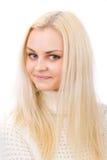 Красивейшая блондинка в белом свитере. Стоковая Фотография