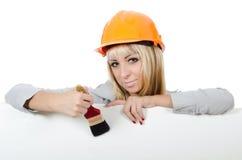 Красивейшая девушка в шлеме здания Стоковые Фото
