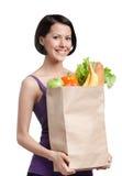 Красивейшая девушка с пакетом плодоовощ стоковое фото rf