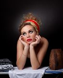 Красивейшая девушка с утюгом Стоковая Фотография RF