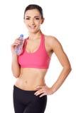 Красивейшая женская питьевая вода спортсмена Стоковая Фотография