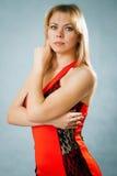 Красивейшая женщина в красном платье Стоковые Изображения