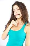Красивейшая женщина думая с волосами в рте смешном Стоковые Фотографии RF