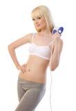 Красивейшая женщина используя massager Стоковая Фотография RF