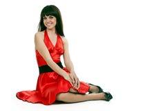 красивейшая женщина красного цвета платья брюнет Стоковое фото RF