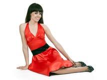 красивейшая женщина красного цвета платья брюнет Стоковая Фотография RF