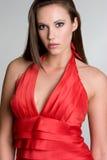 красивейшая женщина красного цвета платья Стоковая Фотография