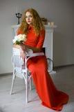 красивейшая женщина красного цвета платья Стоковые Фотографии RF