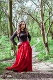 красивейшая женщина красного цвета платья Стоковые Фото