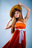 красивейшая женщина померанца платья Стоковое фото RF