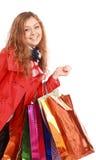 Красивейшая женщина с хозяйственные сумки. Изолировано на белизне. Стоковая Фотография RF