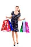 Красивейшая женщина с хозяйственные сумки. на белизне. Стоковое Изображение