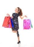 Красивейшая женщина с хозяйственные сумки. на белизне. Стоковые Фотографии RF