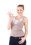 Красивейшая и счастливая маленькая девочка делая одобренный жест, изолированный на whi Стоковое фото RF