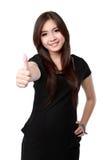 красивейшая коммерсантка показывая большие пальцы руки вверх стоковое фото
