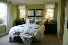красивейшая комната оригинала кровати Стоковая Фотография