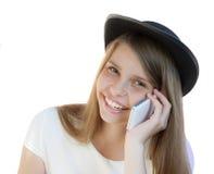Красивейшая маленькая девочка с телефоном белизна изолированная предпосылкой Стоковые Изображения RF