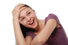 Красивейшая молодая женщина смотря размер в заботливом Стоковые Изображения RF