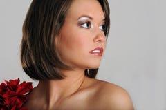 Красивейшая молодая модель смотря к ее левой стороне Стоковые Изображения