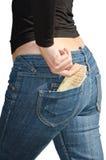 Красивейшая молодая женщина вытягивает вне изолированное евро Стоковое Изображение