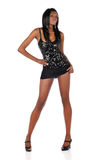 Красивейшая чернокожая женщина нося черное платье стоковое фото rf