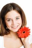 красивейшая яркая женщина красного цвета цветка Стоковые Фото