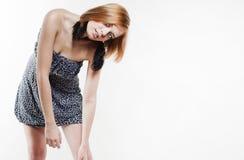 Красивейшая fair-haired девушка в платье стоковое фото