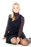 Красивейшее белокурое усаживание девушки Стоковые Фото
