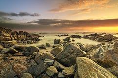 Пристаньте место к берегу с золотистыми тонами, теплый свет Стоковое Фото