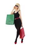 Красивейшие белокурые хозяйственные сумки удерживания женщины Стоковые Фото