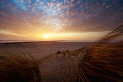 красивейшие дюны зашкурят заход солнца Стоковая Фотография