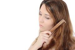 красивейшие расчесывая волосы девушки она Стоковая Фотография