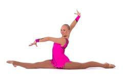 Красивейший гимнаст девушки с сидит на шпагате Стоковая Фотография