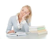 красивейший делая утомлянный студент домашней работы девушки Стоковое фото RF
