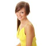 красивейший желтый цвет девушки платья брюнет Стоковые Изображения