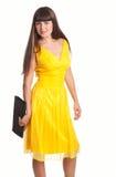 красивейший желтый цвет женщины платья стоковые изображения