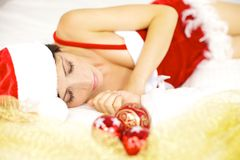 Красивейший женский спать Santa Claus Стоковые Изображения RF
