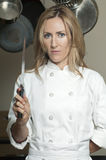 Красивейший женский шеф-повар стоковые фотографии rf