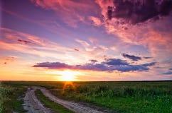 красивейший заход солнца дороги Стоковое фото RF