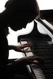 красивейший играть рояля девушки стоковые фото
