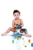 Красивейший малыш играя с его картинами Стоковое Изображение