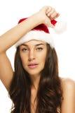 красивейший шлем santas рождества нося детенышей женщины Стоковые Изображения RF