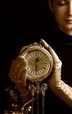 красивейший sepia изображения девушки фокуса часов Стоковая Фотография