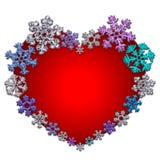 Красивое красное сердце сделанное с снежинками Стоковое Фото