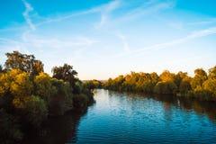 Красивое река на заходе солнца Стоковое Изображение