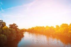 Красивое река на заходе солнца Стоковые Фото