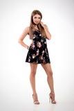 Красивое уверенно платье девушки или женщины вкратце на изолированном whi Стоковые Фото