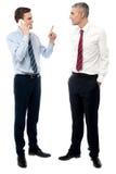 Красивые бизнесмены на обсуждении стоковое изображение rf