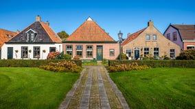 Красивые дома на голландском острове Wadden Schiermonnikoog стоковое фото