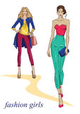 Красивые девушки в модных одеждах иллюстрация вектора